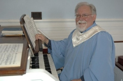 Organist Ron Davis at the Organ in St. James'